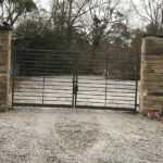 """Custom Steel Ornamental Dual Drive Gates built and installed by """"Monty Ladner Wrought Iron"""" Long Beach, MS."""